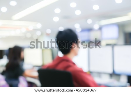 blurred network employee thoughtful about programming system:blurry student workshop in computer station:people research develop data information base concept:group of telecommunication engineer job  - stock photo