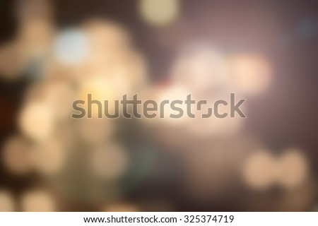 Blurred night city background with circle light. blur backgrounds concept.pastel tone.blur of bokeh circle light christmas festive backdrop concept. - stock photo