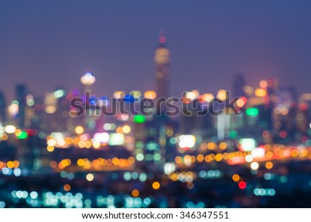 Blurred night downtown city, building background with light bokeh scene.blur backgrounds concept  - stock photo