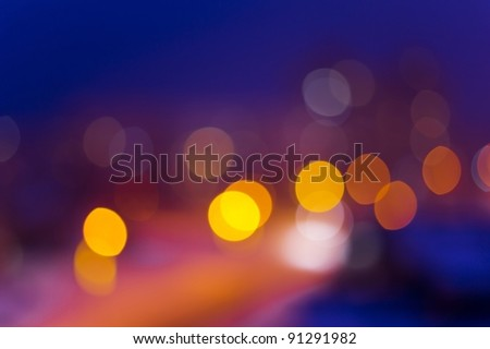 Blurred night view of city in the night - stock photo