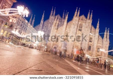 Blurred night view of Milan Duomo. - stock photo