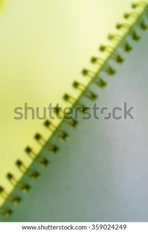 Blurred note book background.
