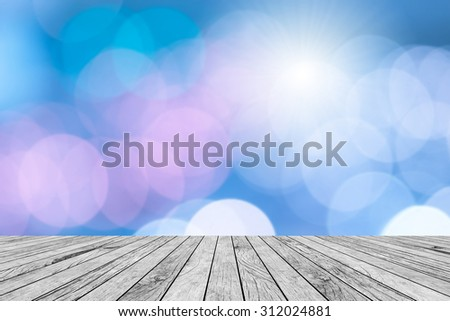 blurred of bokeh circle light christmas festive backdrop  with old aged rustic white wooden tiles concept.xmas wallpaper decoration concept.put and show your product on this backgrounds. - stock photo