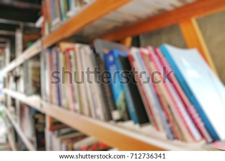 Blurred of books in bookshelf in the library. Education concept.