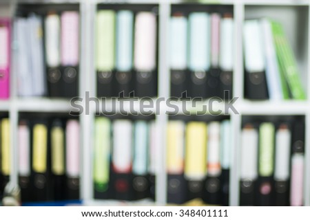 blurred of document file on the shelves at office - stock photo