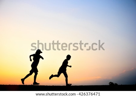 Blurred of Fitness silhouette sunrise jogging workout wellness concept. - stock photo