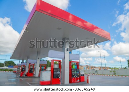 Blurred of gas station with blue sky background. - stock photo