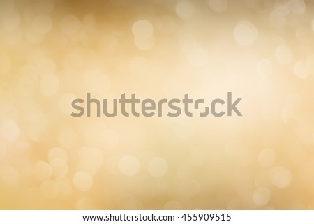 blurred of luxury golden bokeh glittering sparkle background:blurry glowing golden color wallpaper display.abstract beautiful golden metallic material surface wallpaper for decoration design:elelgant - stock photo