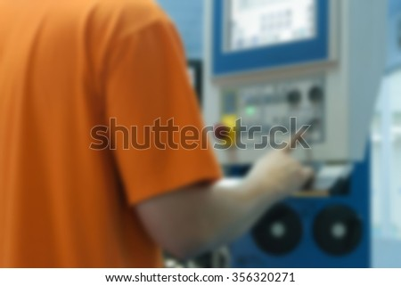 Blurred of Man working for control and monitor printing in printery - stock photo