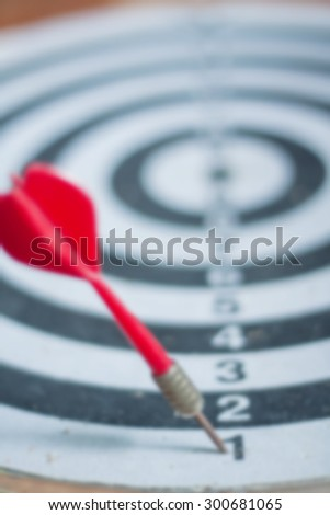 blurred of old dart target with arrows,vintage color tone ,abstract background to solution concept.