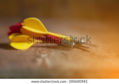 blurred of old red and yellow arrows on wooden, vintage color tone ,abstract background to solution concept. - stock photo