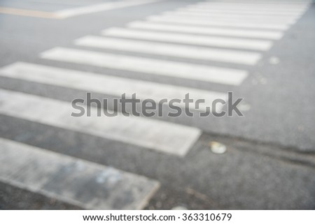 Blurred of pedestrian crossing - stock photo
