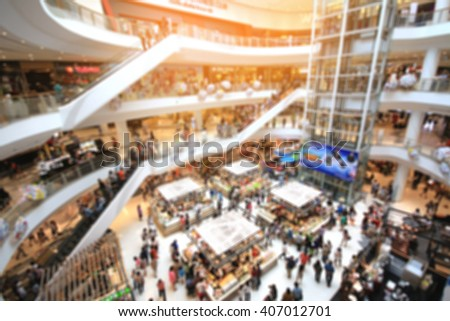 Blurred of people walking in shopping mall with light