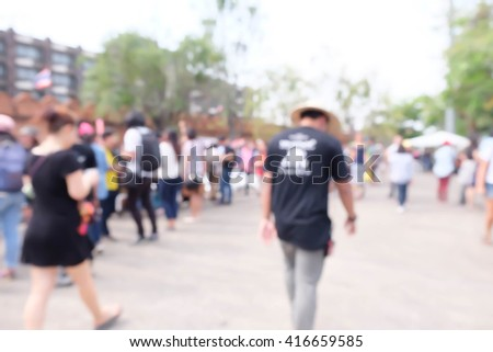 blurred of people walking in the city