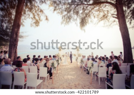 Blurred of wedding on the beach as background (vintage color toned image)