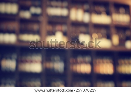 Blurred of wine bottles - stock photo