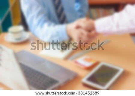 blurred office background , office worker at the computer, working day