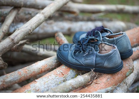 blurred old shoes sport on wood. - stock photo