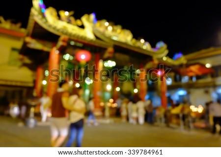 Blurred or Defocus,The Couple Pray at Kuan Yim Shrine , Chinatown , Yaowarat Road , Bangkok Thailand - stock photo