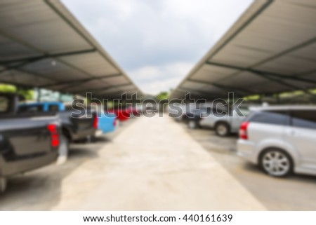 Blurred outdoor cars parking area. Background for your business and transportation concept - stock photo