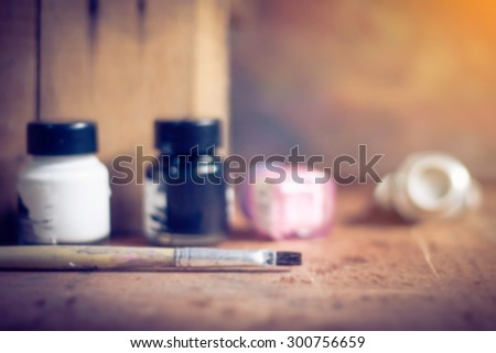 blurred paintbrushes,color and dirty photo flame on wooden background,back vintage grunge style.  - stock photo