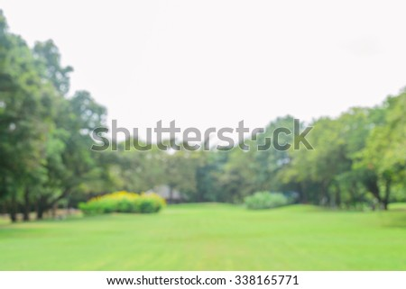 Blurred park with bokeh light. nature blur background. Spring meadow with big tree with fresh green leaves. Vintage effect style pictures. - stock photo