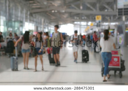 blurred passenger in the interior of the airport - stock photo