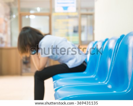 Blurred Patients In Doctors Waiting Room - stock photo