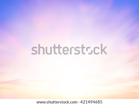 Blurred peaceful landscape sunset. Colorful pink blur glowing bokeh and blue sky. Soft focus open view nature. Abstract background Orange and purple gradient. Sunbeam summer rays light sandy beach. - stock photo