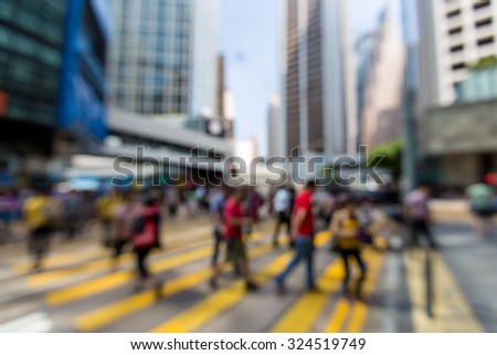 Blurred Pedestrians in Central Business District of Hong Kong - Defocused - stock photo