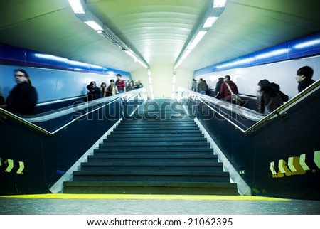 Blurred people commuting between subway stations - stock photo