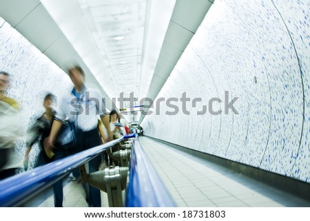 Blurred people commuting between underground stations. - stock photo