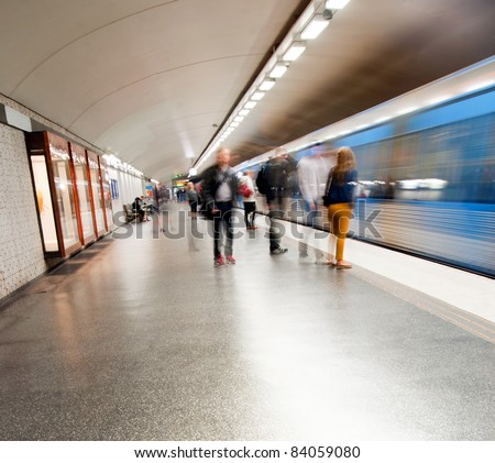 Blurred people in subway station, waiting for the train - stock photo