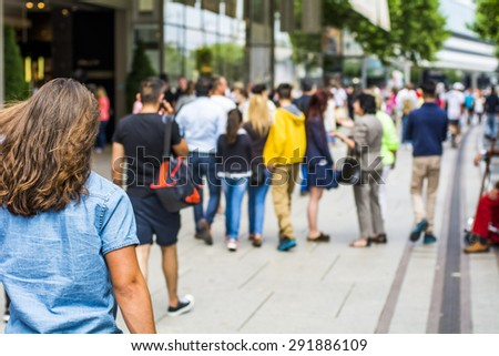 Blurred people in the street  - stock photo