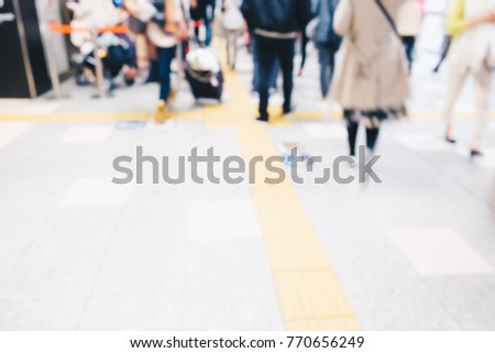 Blurred people in train station movement rush hour background