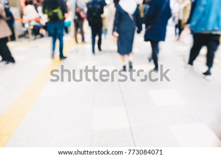 Blurred people in train station with copy space movement rush hour background