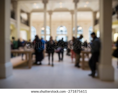 Blurred People inside Apple Store. Paris, France. - stock photo