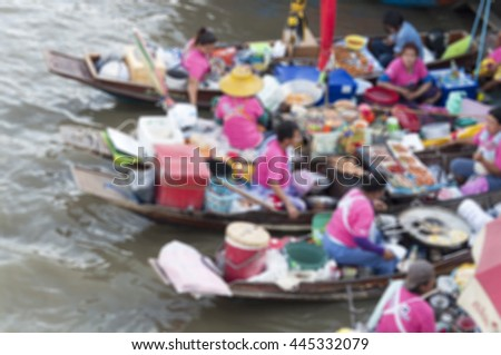 blurred people on floating market - stock photo