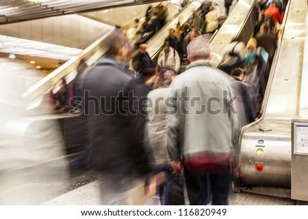 Blurred People on the Escalator - stock photo