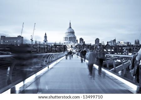 Blurred people on the Millennium bridge, London. - stock photo