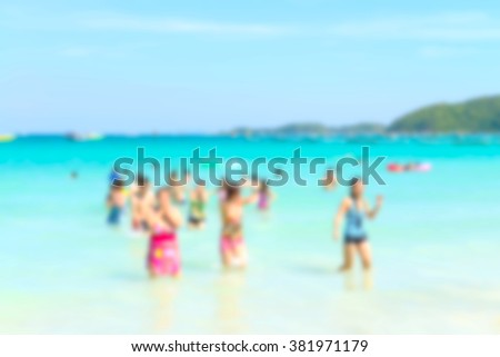 Blurred people relaxing on the beach, summer holiday background concept