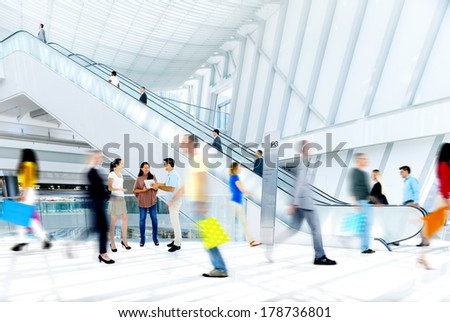 Blurred People Rushing in Shopping Mall - stock photo