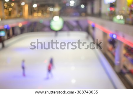 Blurred  people skating on the ice rink.