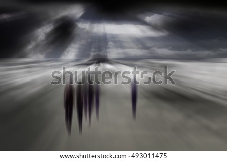 Blurred people walking in a mysterious background