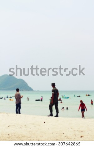 Blurred people walking on the beach