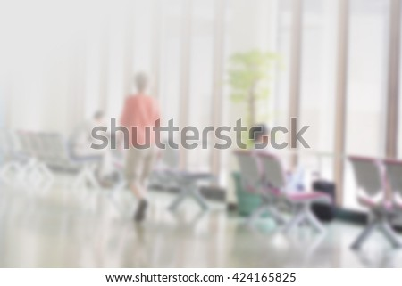Blurred photo of an airport terminal with luggage. Blurred background for topics of travel and transportation. - stock photo