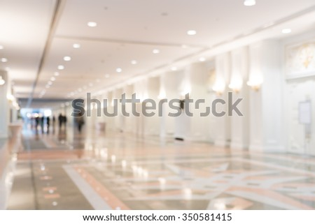 Blurred photo of corridor in modern building, background uses - stock photo