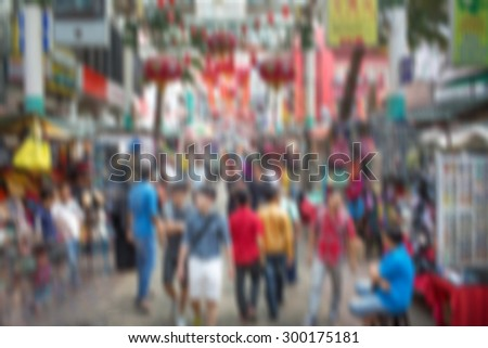 Blurred photo of  Hong-Kong people walking at street marketplace
