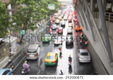 Blurred photo of  traffic jam in rainy day. Bangkok Thailand.