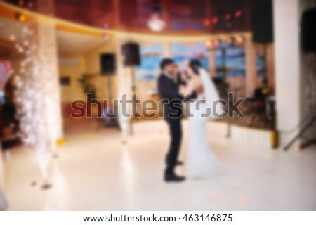 blurred photo of wedding couple dancing, indian groom and caucasian bride,